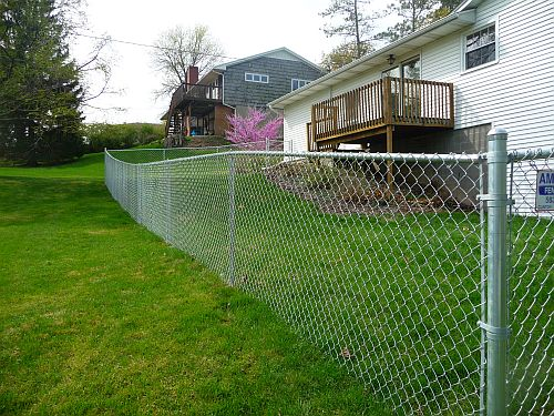 5u0027 tall galvanized chainlink fence with downhill grade
